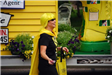 Girl in Yellow Wig and Cape in Parade