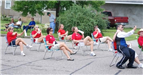Group of People Sitting in Lawn Chairs in Parade