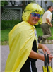 Man in Yellow Wig and Cape in Parade