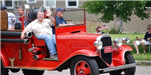 Men in old Red Truck