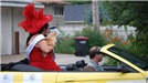 Woman with Cat and Red Dress Riding Down Parade Route