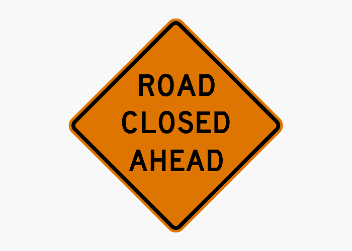 Road Closed sign with a gray background