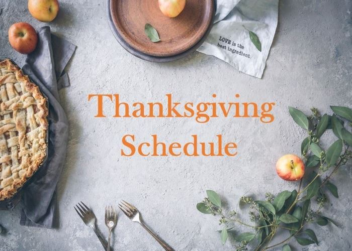 Image of a table set for Thanksgiving with the words &#34Thanksgiving Schedule&#34 written on it.