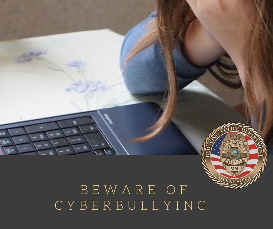 "Image of a girl leaning over a laptop with the words ""Beware of Cyberbullying"" and the RWPD se"
