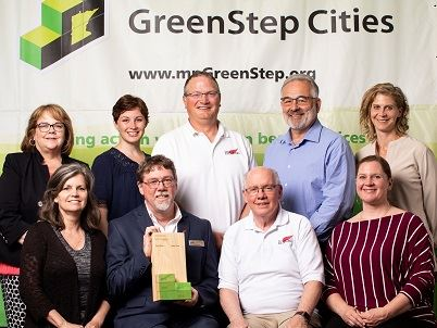 Photo of City of Red Wing staff, Council members, and Mayor accepting a GreenStep Cities award.