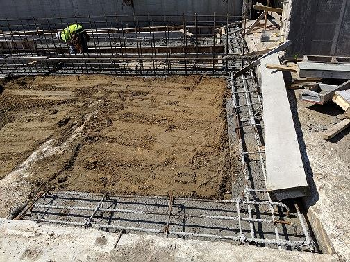 Photo of in-progress backfill at RDF loadout right after concrete pour