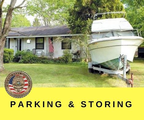 "Image of a boat on a trailer in front of a home with black letters ""Parking & Storing"" and RWP"