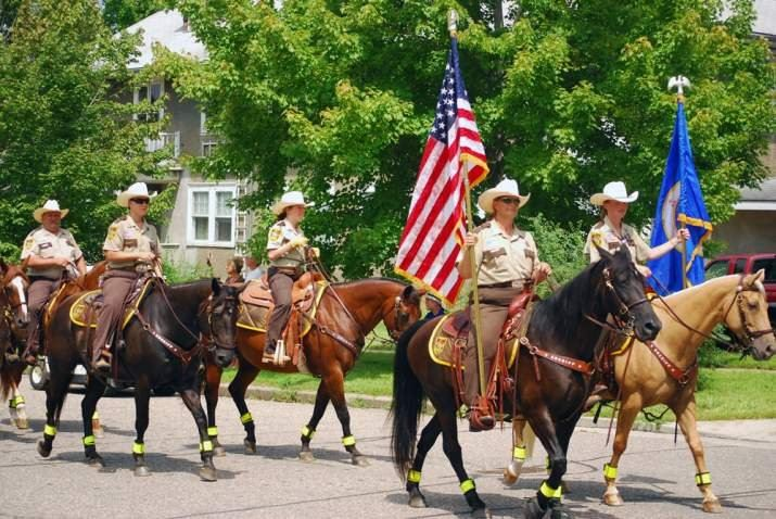 Police Department Riding Horses Down Parade Route