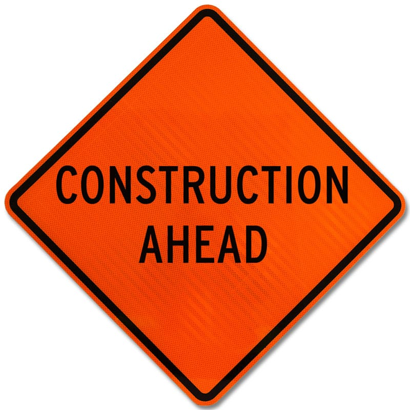Orange diamond construction sign stating, &#34Construction Ahead&#34