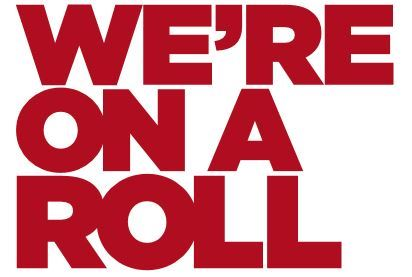 "Large red letters stating, ""WE'RE ON A ROLL!"""